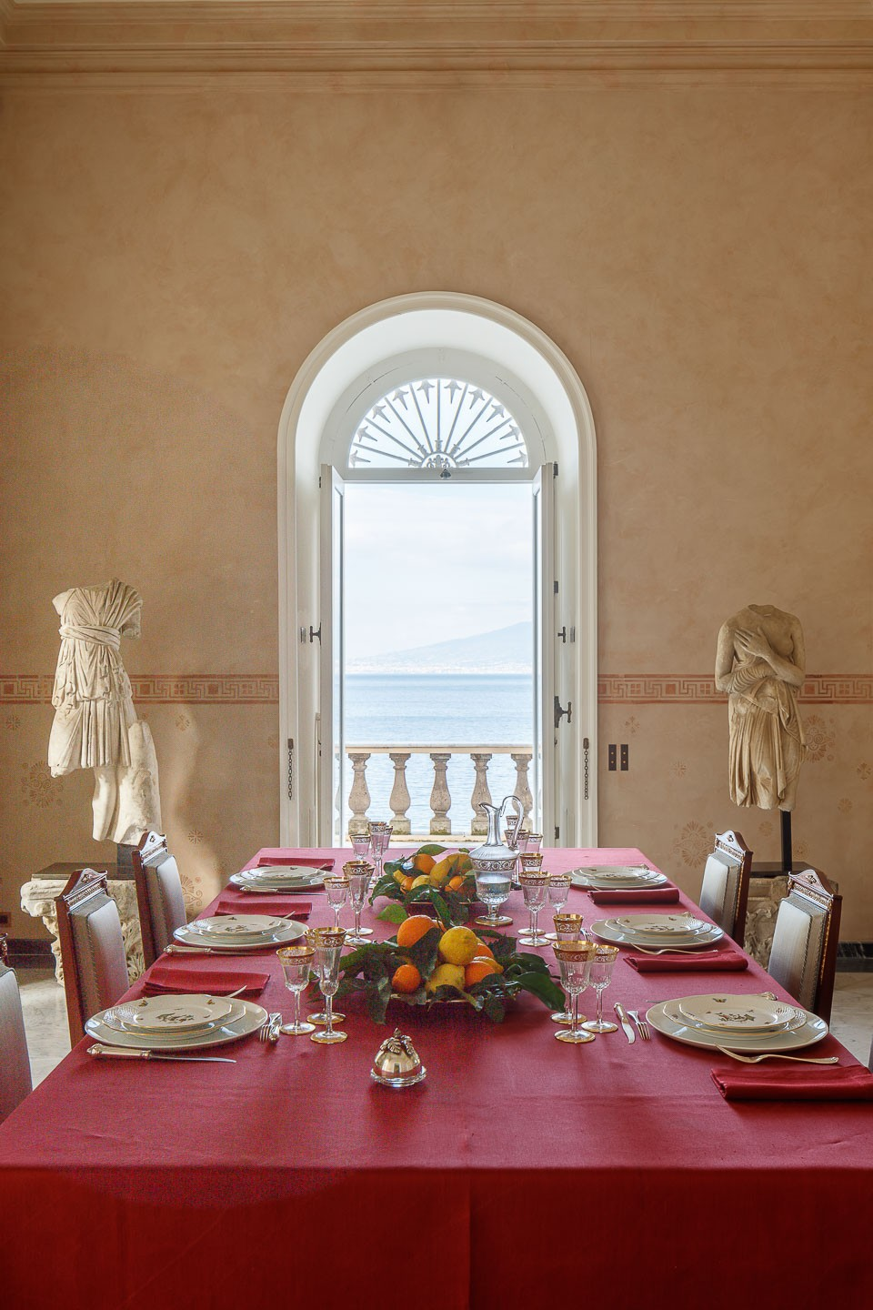 Villa Astor best exquisite dinning room marble table luxury linen glasses table setting decor decoration Italian fruit wine food breathtaking view The Heritage Collection
